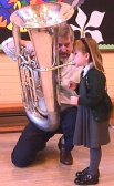 Little Girl Playing Tuba